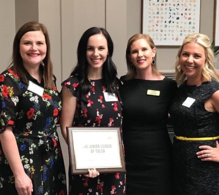 The Junior League of Tulsa receives Child Abuse Network's 2019 Distinguished Service Award. From left: Rita Moschovidis Burke, JLT President 2016-17; Ashley Pettingell, JLT President-Elect 2019-20; Maura Guten, Child Abuse Network President & CEO; Darci Newell Hoff, JLT Membership Programs Vice President 2019-20.